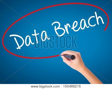 Women Hand Writing Data Breach With Black Marker On Visual Screen