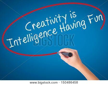 Women Hand Writing Creativity Is Intelligence Having Fun With Black Marker On Visual Screen