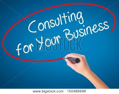 Women Hand Writing Consulting For Your Business With Black Marker On Visual Screen