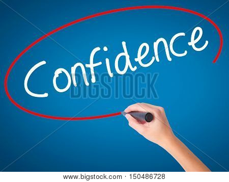 Women Hand Writing Confidence With Black Marker On Visual Screen
