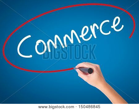 Women Hand Writing Commerce With Black Marker On Visual Screen.