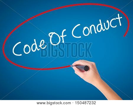 Women Hand Writing Code Of Conduct With Black Marker On Visual Screen