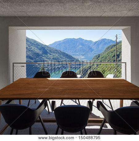Modern house veranda, table with lake view