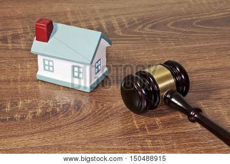 gavel on the table, gavel on a wooden table, wooden background