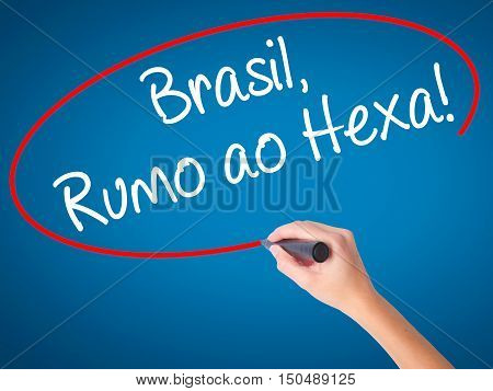 Women Hand Writing Brasil, Rumo Ao Hexa! With Black Marker On Visual Screen.