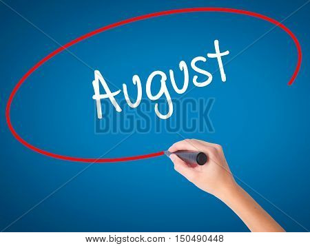 Women Hand Writing August  With Black Marker On Visual Screen