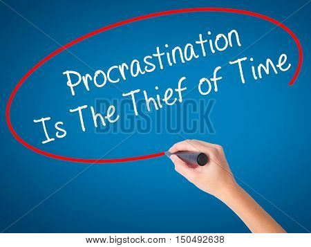 Women Hand Writing  Procrastination Is The Thief Of Time With Black Marker On Visual Screen