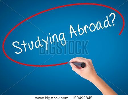 Women Hand Writing Studying Abroad? Black Marker On Visual Screen