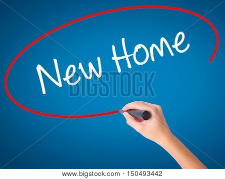 Women Hand Writing New Home  With Black Marker On Visual Screen