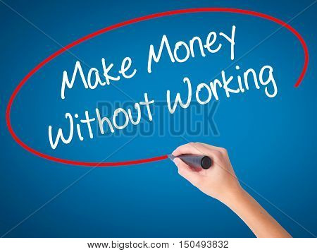 Women Hand Writing Make Money Without Working With Black Marker On Visual Screen
