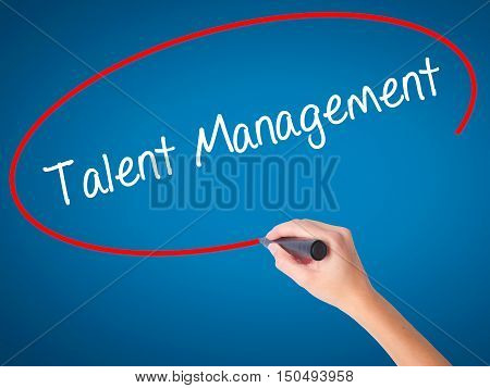 Women Hand Writing Talent Management With Black Marker On Visual Screen