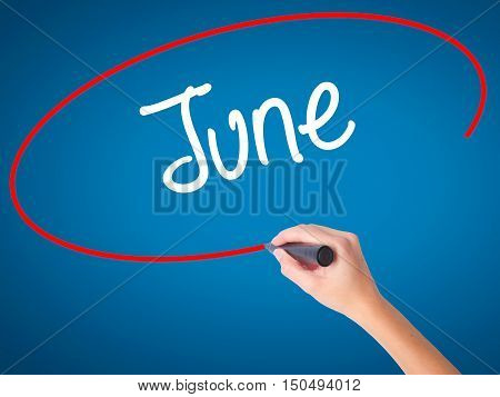 Women Hand Writing June  With Black Marker On Visual Screen