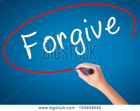 Man Hand Writing Forgive With Black Marker On Visual Screen