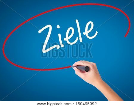 Man Hand Writing Ziele  (goalsin German) With Black Marker On Visual Screen