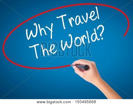 Man Hand Writing  Why Travel The World? With Black Marker On Visual Screen