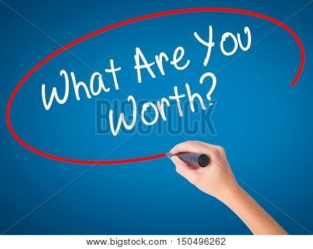 Man Hand Writing What Are You Worth? With Black Marker On Visual Screen.
