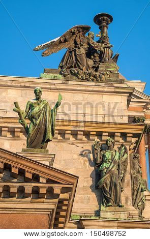 Sculptures of angels and archangels adorn the pediment of St. Isaac's Cathedral in St. Petersburg