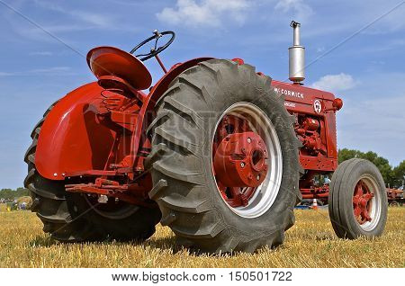 ROLLAG, MINNESOTA, Sept 1. 2016: An old restored classic McCormick tractor is  displayed at the West Central Steam Threshers Reunion in Rollag, MN attended by 1000's held annually on Labor Day weekend.