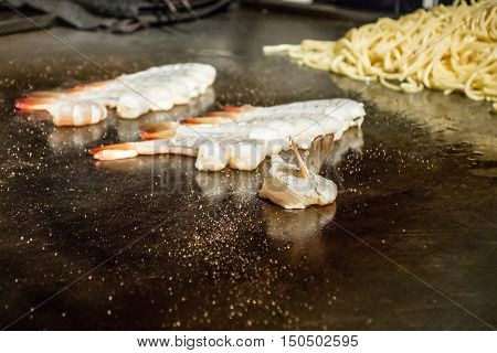food being brepared at a japanese steakhouse
