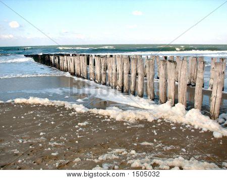 Wooden Pillars In The Ocean