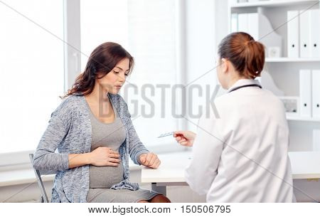 pregnancy, gynecology, medicine, health care and people concept - gynecologist doctor and pregnant woman meeting at hospital