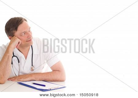 Thoughtful Doctor Sitting At The Desk