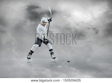Ice hockey player in white in action outdoor under blue sky with clouds