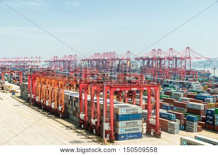Shanghai China - July 19 2016: Scene of Shanghai port container freight terminal. Shanghai became the world's largest container port and plays a dominant role in the trade between East and West.