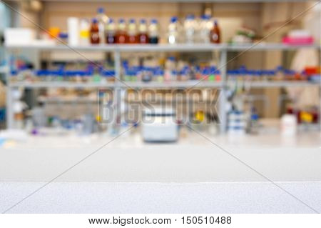 empty laboratory top or bench against blurred la1boratory