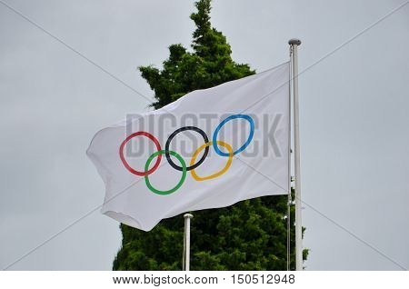 LAUSANNE,SWITZERLAND, SEPTEMBER, 19, 2016: Olympic flag at Olympic museum in Switzerland in September 19, 2016. The symbol of the Olympic Games was originally designed in 1912 by Baron Pierre de Coubertin.