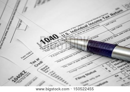 Tax form 1040 with pen. Business concept