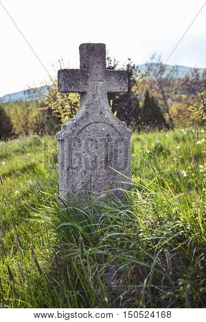 Old Grave On Traditional European Cemetery In Slovakia. Aged Cross Tomb Stone On Grave Yard In Sprin