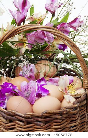 Basket Full Of Easter Eggs And Flower