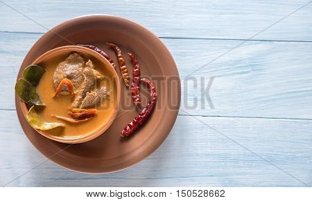Bowl of thai panang curry on the wooden background