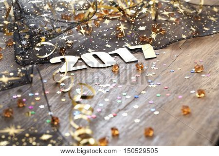 Happy New Year 2017 on wooden background