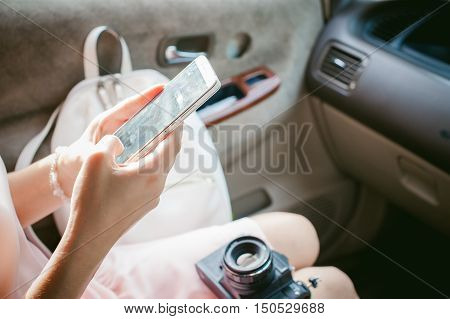 Girl With Red Hair Sitting In The Car, To Make Payments For Online Purchases From Your Device Using