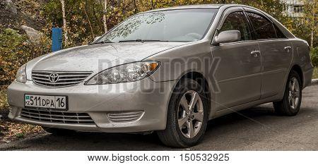 Kazakhstan, Ust-Kamenogorsk, october 6, 2016: Toyota Camry XV30, white car,  japanese car in the street, sedan