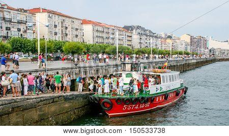 Santander, Spain - August 15: passengers get off the cutter on the embankment in Santander - on August 15, 2009 in Santander Cantabria Spain