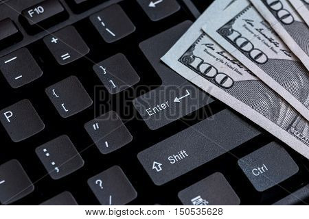 black keyboard with us dolalr bills isolated