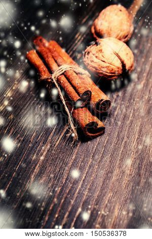 Winter spices over wooden background close up. Christmas card with anise and cinnamon