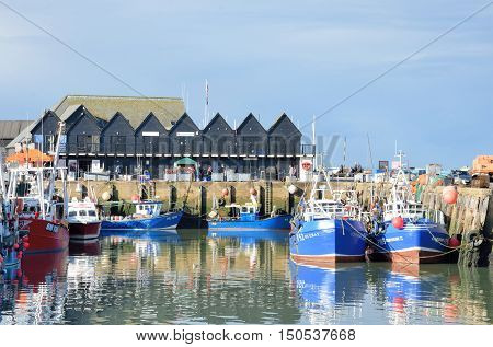 Whitstable United Kingdom - Otcober 1 2016: Fishing Boats and fishermans sheds in Whitstable Harbour