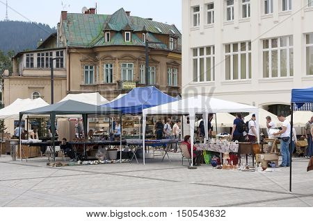 ZAKOPANE POLAND - SEPTEMBER 15 2016: Antiques that was put on sale can be seen on stalls placed on the famous Independence Square in the downtown