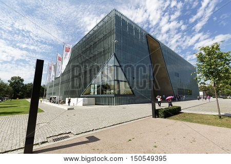 WARSAW POLAND - AUGUST 05 2016: Modern building of the Museum of the History of Polish Jews that is commonly known as The Polin. The museum documents the millennial tradition of Jews in Poland