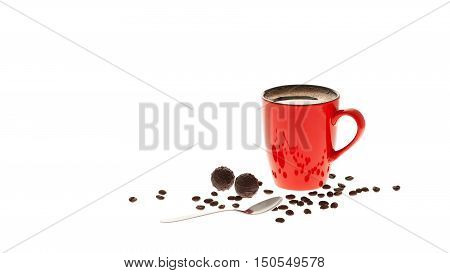 Red cup of coffee coffee beans chocolate and spoon isolated on white background