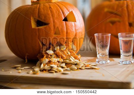 Pumpkin Puking With Pumpkin Seeds On Wood Table, Vodka