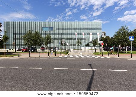 WARSAW POLAND - AUGUST 05 2016: Museum of the History of Polish Jews as seen from afar. It was built in years 2009-2013 and its collections documents the millennial tradition of Jews in Poland