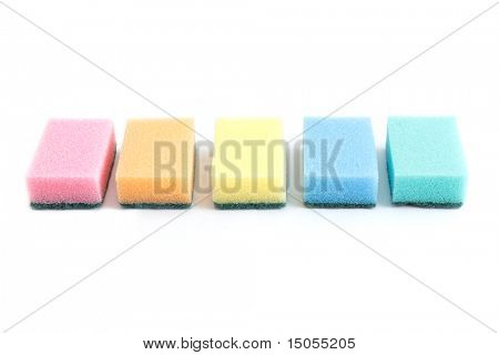 Colourful sponges isolated on a white bg