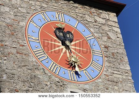 LUCERNE SWITZERLAND - MAY 08 2016: The big shield of the clock placed on the tower of Town Hall that was built in the early 1600s. The Clock Tower height it is over 40 meters
