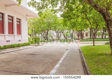 Bangkok Thailand - June 5 2016: Buildings of Faculty of Engineering and surrounding road with various trees Chulalongkorn university