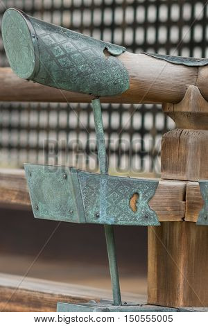 Kyoto Japan - September 14 2016: Closeup of two styles of wooden beam protectors are of a copper-based alloy and highly decorated. They are set at the end of each beam. Imperial Palace.